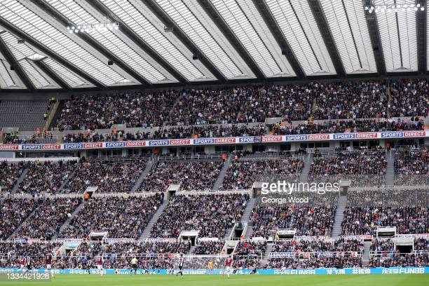 General view inside the stadium as fans watch on during the Premier League match between Newcastle United and West Ham United at St. James Park on...