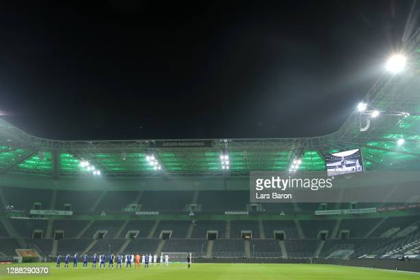 General view inside the stadium as FC Schalke 04 and Borussia Monchengladbach players observe a minutes silence for former footballer, Diego...