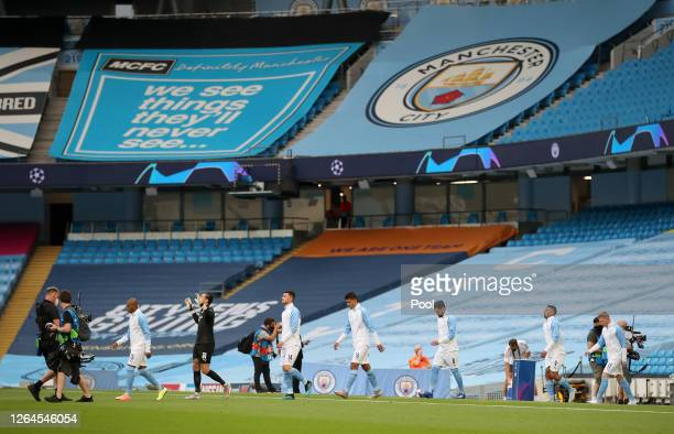 General view inside the stadium as Fernandinho of Manchester City leads his teammates out prior to the UEFA Champions League round of 16 second leg...