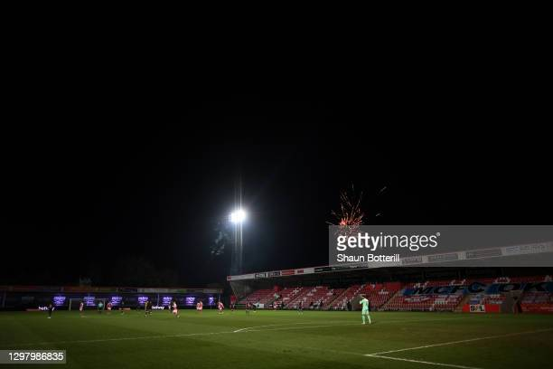 General view inside the stadium as fireworks are seen in the distance during The Emirates FA Cup Fourth Round match between Cheltenham Town and...