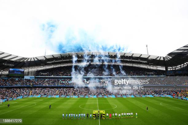 General view inside the stadium as fireworks are seen prior to the Premier League match between Manchester City and Norwich City at Etihad Stadium on...