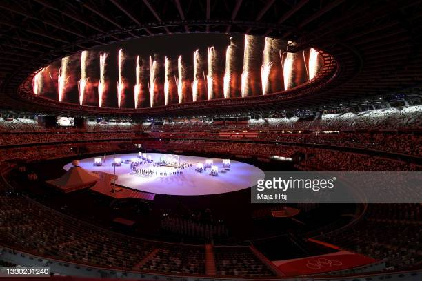 General view inside the stadium as fireworks go off and performers dance during the Opening Ceremony of the Tokyo 2020 Olympic Games at Olympic...