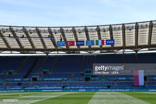 General view inside the stadium as flags of Turkey and Italy are seen beside the flags of UEFA prior to the UEFA Euro 2020 Championship Group A match...