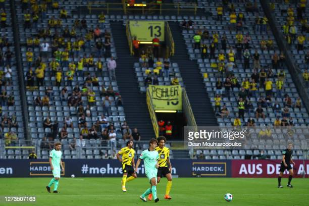 General view inside the stadium as Florian Neuhaus of Borussia Monchengladbach passes the ball under pressure from Axel Witsel of Borussia Dortmund...