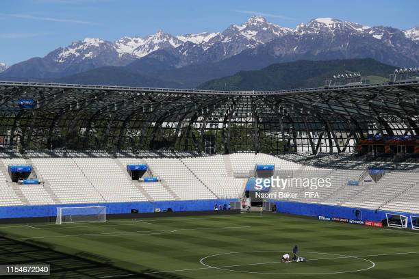 General view inside the stadium as grounds staff prepare the pitch during Day 2 of the FIFA Women's World Cup France 2019 at Stade des Alpes on June...