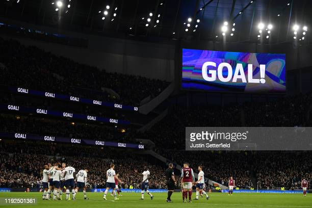 General view inside the stadium as Harry Kane of Tottenham Hotspur celebrates with teammates after scoring his team's fourth goal during the Premier...