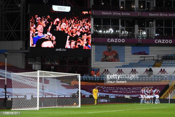 General view inside the stadium as Kortney Hause of Aston Villa celebrates with teammates after scoring his team's second goal, and Aston Villa fans...