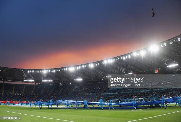 General view inside the stadium as large replica shirts of Italy and Switzerland are brought on to the pitch prior to the UEFA Euro 2020 Championship...