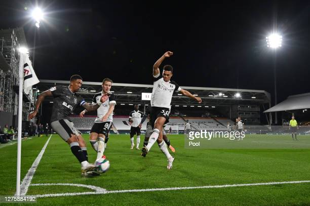 A general view inside the stadium as Liam Palmer of Sheffield Wednesday is closed down by Antonee Robinson of Fulham during the Carabao Cup third...