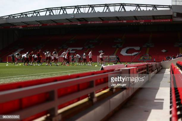 A general view inside the stadium as Liverpool players warm up during a training session at Anfield on May 21 2018 in Liverpool England
