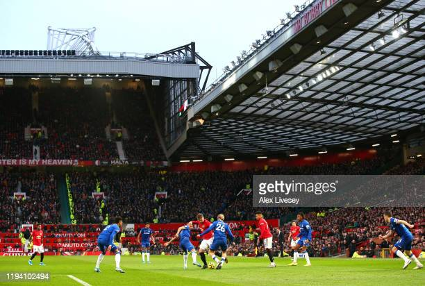 General view inside the stadium as Luke Shaw of Manchester United battles for possession with Richarlison and Tom Davies of Everton during the...