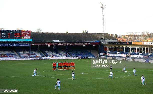 General view inside the stadium as Luton Town players huddle together, as AFC Bournemouth players take a knee in support of the Black Lives Matter...