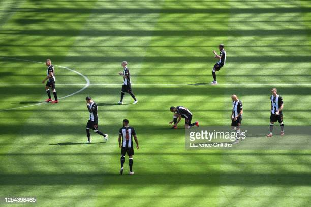 General view inside the stadium as Newcastle United players walk out to the pitch for the second half during the Premier League match between...