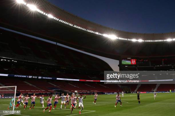 General view inside the stadium as players compete for the ball in the penalty area during the La Liga match between Club Atletico de Madrid and Real...