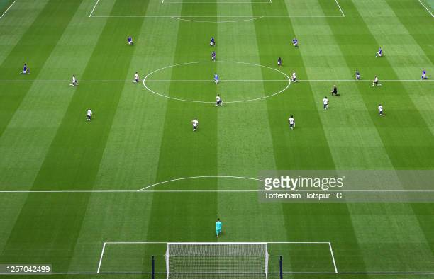 A general view inside the stadium as players from both teams take a knee in support of the Black Lives Matter movement during the Premier League...