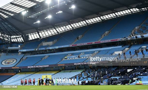 General view inside the stadium as players line up prior to the Premier League match between Manchester City and Manchester United at Etihad Stadium...