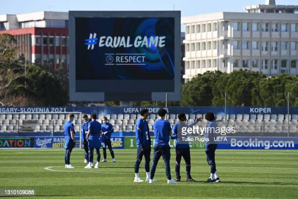 """General view inside the stadium as players of England U21's inspect the pitch whilst the LED Screen shows a """"#Equal Game"""" logo prior to the 2021 UEFA..."""