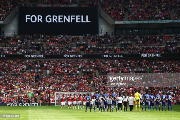 General view inside the stadium as players officals and fans take part in a minute of silence in memory of the Grenfell Tower victims during the The...