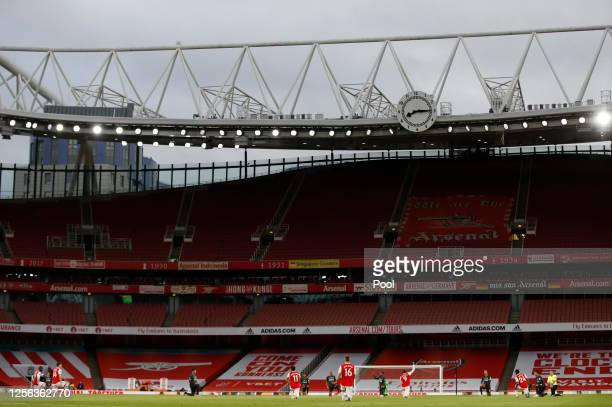 General view inside the stadium as Players takes a knee in support of the Black Lives Matter movement prior to during the Premier League match...