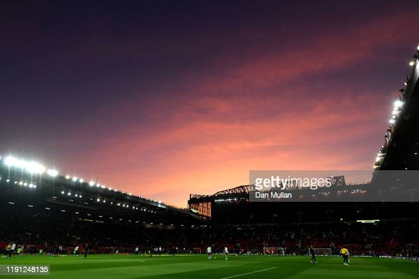 General view inside the stadium as players warm up as the sun sets ahead of the Premier League match between Manchester United and Aston Villa at Old...