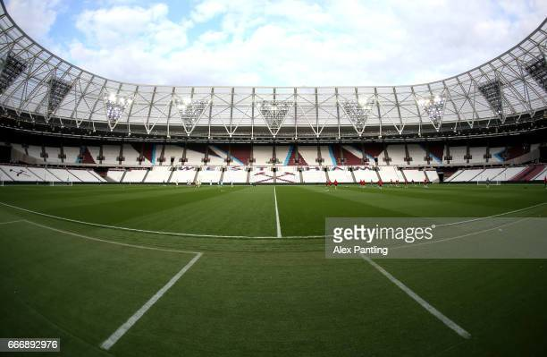 A general view inside the stadium as players warm up prior to the Premier League 2 match between West Ham United and Middlesbrough at London Stadium...