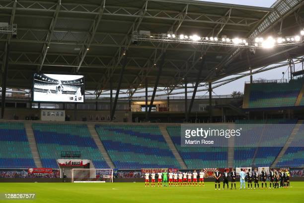 General view inside the stadium as RB Leipzig and DSC Arminia Bielefeld players observe a minutes silence for former footballer, Diego Maradona, who...