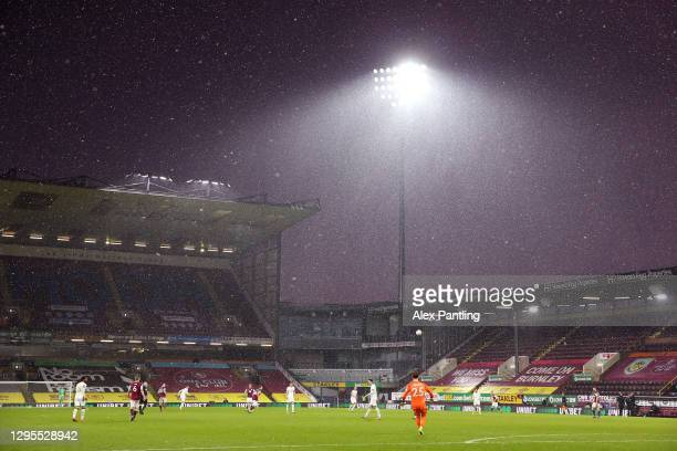 General view inside the stadium as snow comes down during the FA Cup Third Round match between Burnley and Milton Keynes Dons at Turf Moor on January...