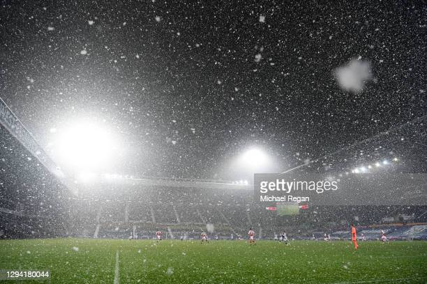 General view inside the stadium as snow falls during play during the Premier League match between West Bromwich Albion and Arsenal at The Hawthorns...