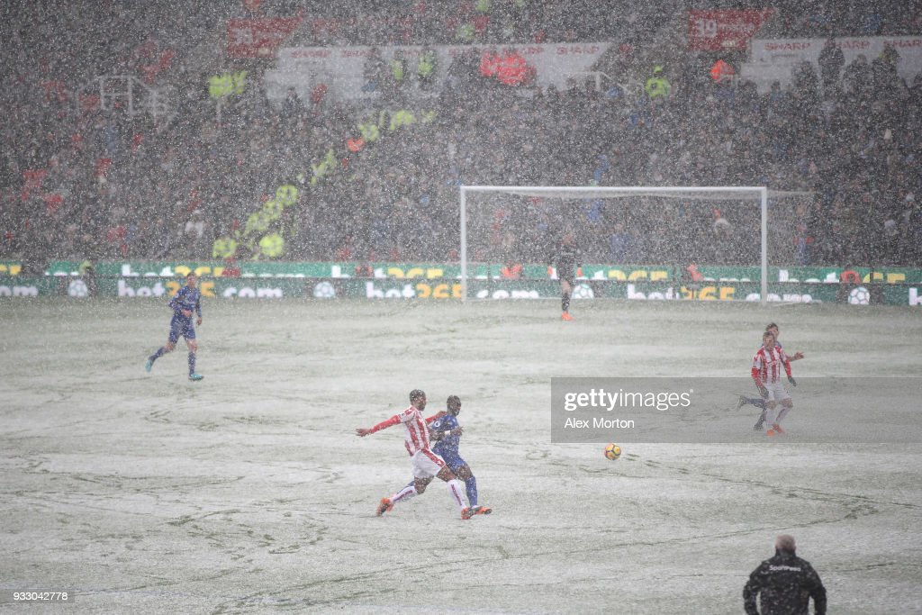 General view inside the stadium as snow falls during the Premier League match between Stoke City and Everton at Bet365 Stadium on March 17, 2018 in Stoke on Trent, England.
