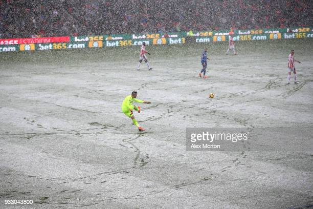 General view inside the stadium as snow falls during the Premier League match between Stoke City and Everton at Bet365 Stadium on March 17 2018 in...