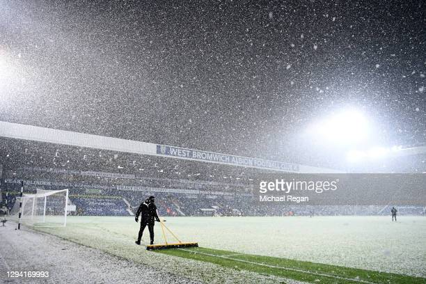 General view inside the stadium as snowfall is seen prior to during the Premier League match between West Bromwich Albion and Arsenal at The...