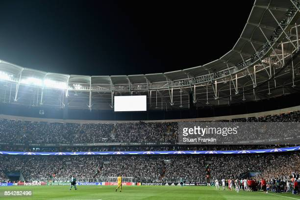 General view inside the stadium as some of the flood lights go out during the UEFA Champions League Group G match between Besiktas and RB Leipzig at...