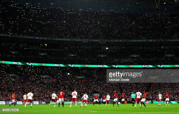 A general view inside the stadium as Southampton fans light up the stadium during the EFL Cup Final between Manchester United and Southampton at...