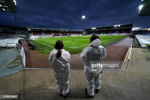 General view inside the stadium as staff wearing personal protective equipment look on prior to the Premier League match between Burnley and...