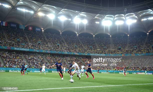 General view inside the stadium as Steven Zuber of Switzerland battles for possession with Raphael Varane of France during the UEFA Euro 2020...