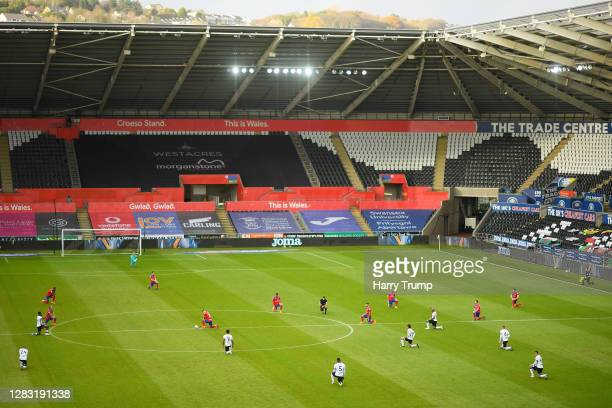 General view inside the stadium as Swansea City and Blackburn Rovers players take a knee in support of the Black Lives Matter Movement prior to the...