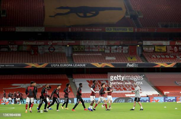 General view inside the stadium as the Arsenal players warm up prior to the UEFA Europa League Group B stage match between Arsenal FC and Dundalk FC...
