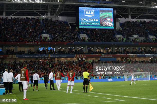 General view inside the stadium as the big screen informs fans of a VAR review happening regarding Iago Aspas of Spain's goal during the 2018 FIFA...