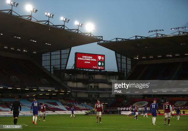 General view inside the stadium as the big screen shows a VAR check during the Premier League match between Burnley and Chelsea at Turf Moor on...