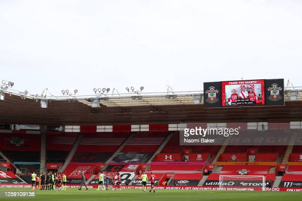 A general view inside the stadium as the big screen shows thank you messages from fans following the Premier League match between Southampton FC and...