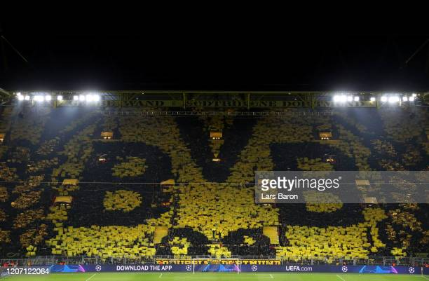 General view inside the stadium as the Borussia Dortmund fans hold up a tifo during the UEFA Champions League round of 16 first leg match between...