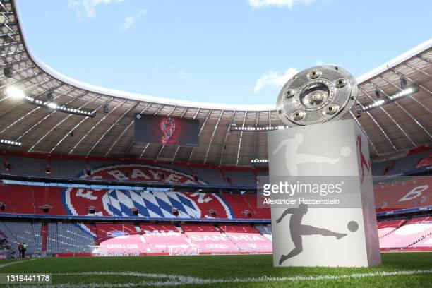 General view inside the stadium as the Bundesliga Meisterschale Trophy is seen on a plinth ahead of the Bundesliga match between FC Bayern München...