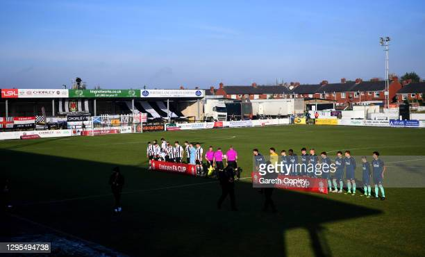 General view inside the stadium as the Chorley FC and Derby County players line up behind the Emirates FA Cup branded boards prior to the FA Cup...