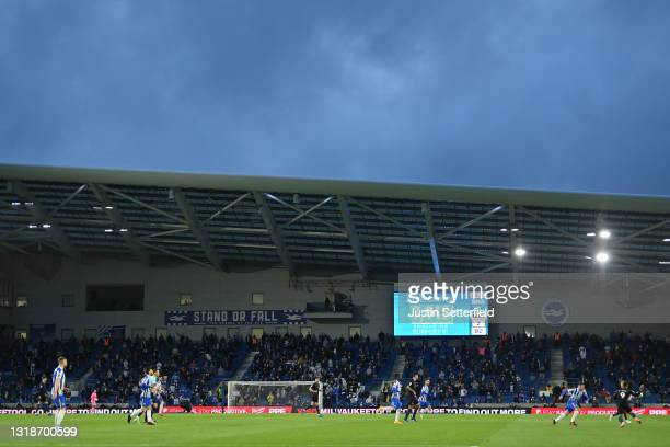 """General view inside the stadium as the LED screen shows todays attendance as """"7945"""" during the Premier League match between Brighton & Hove Albion..."""
