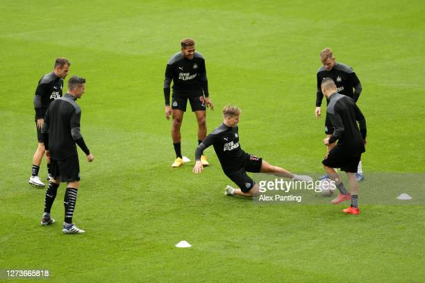 General view inside the stadium as the Newcastle United players warm up prior to the Premier League match between Newcastle United and Brighton &...