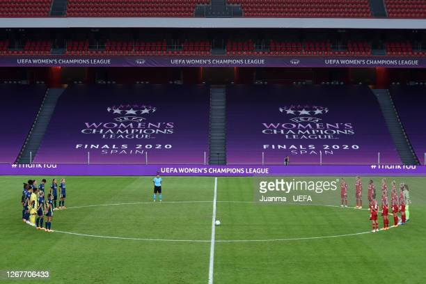 General view inside the stadium as the Olympique Lyon and FC Bayern Munich players observe a minute of silence for those who have lost their lives to...