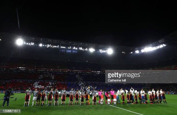 General view inside the stadium as the Olympique Lyon and Juventus players line up prior to the UEFA Champions League round of 16 first leg match...