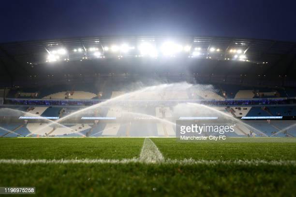 General view inside the stadium as the pitch is watered ahead of the Premier League match between Manchester City and Everton FC at Etihad Stadium on...