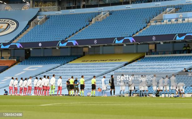 General view inside the stadium as the Real Madrid and Manchester City teams line up prior to the UEFA Champions League round of 16 second leg match...