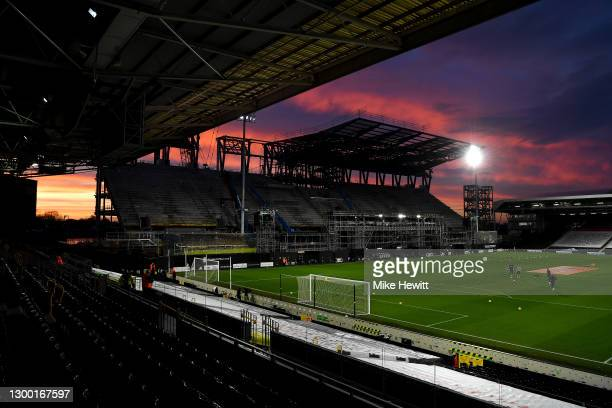 General view inside the stadium as the sun sets and the under construction new stand is seen prior to the Premier League match between Fulham and...
